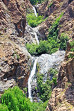 Beautiful view of mountains and a waterfall. Beautiful view of Atlas mountains and a waterfall Royalty Free Stock Photos