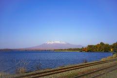 Beautiful view of Mt. Komagatake alongside railway track, near O Stock Photo