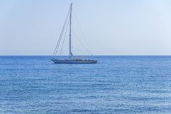 Beautiful view at natural blue sea with luxury docked travel boat. On the sea on summer clear day stock images