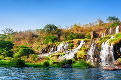 Beautiful view of natural cascading waterfall and pool in autumn royalty free stock images