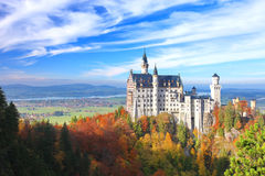 Beautiful view of the Neuschwanstein castle in autumn. Neuschwanstein Castle is a nineteenth-century palace on a rugged hill above the village near Fussen in Royalty Free Stock Image