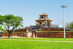 Beautiful view of the Ngan Gate, the Citadel, Hue, Vietnam. Beautiful view of the Ngan Gate in fortress wall of the Citadel on blue sky background in Hue stock photos