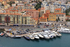 Beautiful view of Nice (Cote d'Azur, France). With marina, ships and multicolor houses. View from above Stock Image