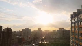 Beautiful view of Novosibirsk skyline at sunset and playground by the windows stock video footage