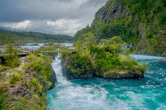 Beautiful view o turquoise water flowing in Petrohue River, Llanquihue Province, Los Lagos Region, Chile.  royalty free stock photography