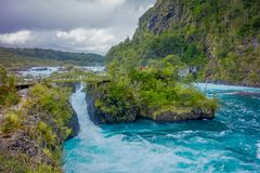 Beautiful view o turquoise water flowing in Petrohue River, Llanquihue Province, Los Lagos Region, Chile.  stock photography