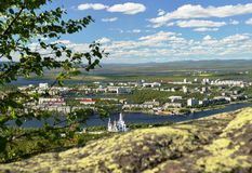 Beautiful view from observation deck on Mount Poazuainchev translated from the Sami - Deer Mountain into small northern town lyi. Monchegorsk, Russia, Kola Royalty Free Stock Photography