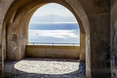 Beautiful view of the ocean through the arches of a balcony royalty free stock image
