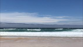 Ocean waves and beach scenery. Beautiful view of ocean waves and beach scenery at Bondi Beach, Australia stock footage
