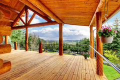 Beautiful View Of The Log Cabin House Porch. Royalty Free Stock Photo