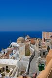 Beautiful view on Oia village and wind mill Royalty Free Stock Images