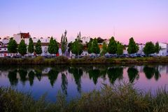 Beautiful view on the old city of Tavira and the river Gilao. View on the old city of Tavira with beautiful white houses and the river Gilao on the sunset royalty free stock images