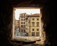 Beautiful view, through the old window on piazza in Florence. FLORENCE, ITALIA - MARCH 30, 2016 Beautiful view, through the old window on piazza in Florence Stock Photos