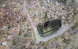 Aerial view of an old wooden church and a cemetery from Maramures, Romania Royalty Free Stock Images