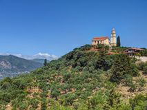 Beautiful view on orange roofing temple church on top of green hills mountains on Greece island Zakynth and blue sky. Greece lands. Cape. Greece tourism holidays royalty free stock image