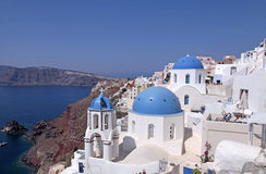Beautiful view with  orthodox church in Oia, Santorini island, G. Beautiful view with white and blue orthodox church in the village of Oia, Santorini island Royalty Free Stock Photo