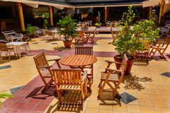 Beautiful view of outdoor patio at Playa Pesquero hotel grounds on sunny day Royalty Free Stock Images