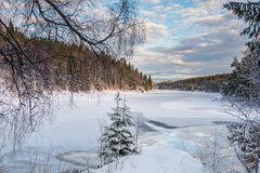 View over the cold snowy lake in evening light Stock Photo