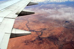 Beautiful view over the desert, seen from jet plane`s window seat Royalty Free Stock Images