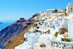 Beautiful clifftop cave houses vacation hotels Santorini Royalty Free Stock Images