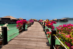 Beautiful view of overwater bungalows in resort. Overwater bungalows and wooden jetty.Beautiful view of water villas in resort.Summer vacation concept royalty free stock image