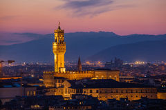 Beautiful view of Palazzo Vecchio in evening illumination and  river Arno, Florence Stock Image