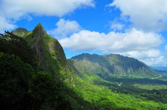 Beautiful view of Pali Lookout, Oahu,Hawaii. Beautiful view of Pali Lookout on a gorgeous day. Lush green hills, blue sky and just the right amount of clouds in Stock Photo