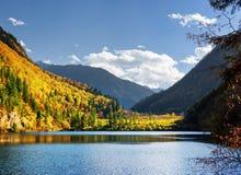Beautiful view of the Panda Lake among colorful fall woods Royalty Free Stock Photography