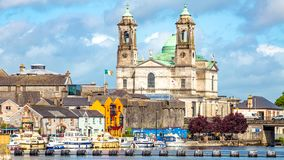 Beautiful view of the parish church of Ss. Peter and Paul and the castle in the town of Athlone next to the river Shannon. Wonderful cloudy day in the county stock photography