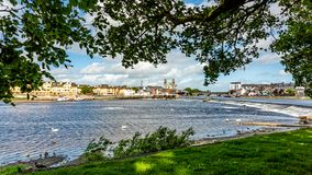 Beautiful view from a park of the river Shannon with the town of Athlone in the background. Wonderful sunny day to enjoy in the county of Westmeath, Ireland royalty free stock images