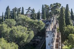 Beautiful view of a part of the gardens and the castle wall of Gibralfaro. Wonderful day with a blue sky in Malaga Spain stock photo