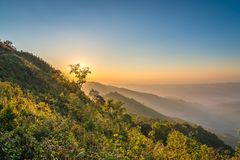 View of Phu Chi Dao in sunset time with layers of mountain in Chiang Rai, Thailand. Beautiful view of Phu Chi Dao in sunset time with layers of mountain in stock photo