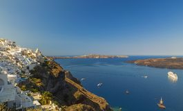 Beautiful view of picturesque town of Thira, caldera and volcano on Mediterranean Sea. Traditional white architecture of the islan. Beautiful view of picturesque stock photography