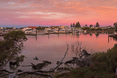 Beautiful view of pink sky over Lake Butler boat marina during s Stock Photo