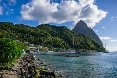 Soufriere Harbor overlooking the water and pitons stock images