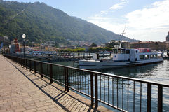 Beautiful view point from Como quay on lake, city and mountain, sunny day, Como, Italy, summer 2016 Royalty Free Stock Images