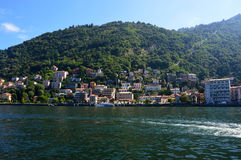 Beautiful view point from Como quay on lake, city and mountain, sunny day, Como, Italy, summer 2016 Stock Image