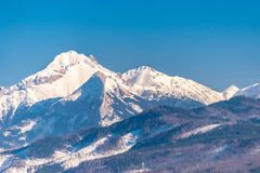 A beautiful view of the Polish Tatra Mountains. Sunny, beautiful day in the winter, snow-capped mountains and blue sky. stock photos