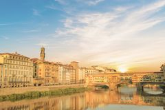 Beautiful view of the Ponte Vecchio bridge across the Arno River in Florence, Italy. On a sunny day royalty free stock image