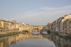 Beautiful view of the Ponte Vecchio bridge across the Arno River in Florence, Italy. On a sunny day royalty free stock photos
