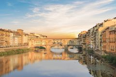 Beautiful view of the Ponte Vecchio bridge across the Arno River in Florence, Italy. On a sunny day stock photo