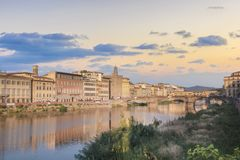 Beautiful view of the Ponte Vecchio bridge across the Arno River in Florence, Italy. On a sunny day royalty free stock photo