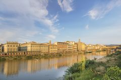 Beautiful view of the Ponte Vecchio bridge across the Arno River in Florence, Italy. On a sunny day stock photography