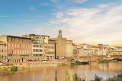 Beautiful view of the Ponte Vecchio bridge across the Arno River in Florence, Italy. On a sunny day stock image