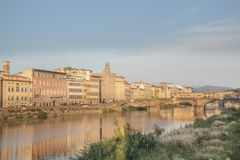 Beautiful view of the Ponte Vecchio bridge across the Arno River in Florence, Italy. On a sunny day stock photos