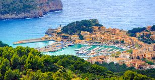 Port de Soller, Mallorca island, Spain. Beautiful view of Port de Soller town, located in a blue lagoon on Mallorca island in Mediterranean sea, Majorca, Spain Stock Photography