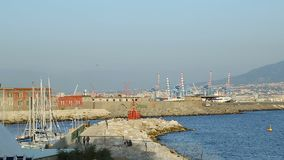 Beautiful view of Port of Naples with industrial cranes, yachts and buildings. Stock footage stock footage
