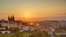 A beautiful view of Prague at sunrise on a misty morning timelapse. A panorama of Prague Old Town with majestic Prague Castle and St. Vitus Cathedral on the stock footage