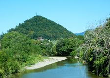 Beautiful view of the pyramid mountain and mountain river. Beautiful view of the pyramidal mountain and the mountain river in the village of Dagomys, Sochi Royalty Free Stock Images