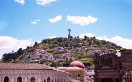 Beautiful view of Quito mixing new architecture with charming streets, with a panecillo turist place in the mountain in. Front, in the city of Quito Royalty Free Stock Images